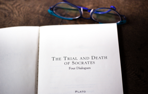 Open book of 'The Trial and Death of Socrates'